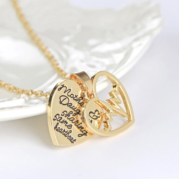 Mother Daughter Sharing Same Heartbeat Necklaces