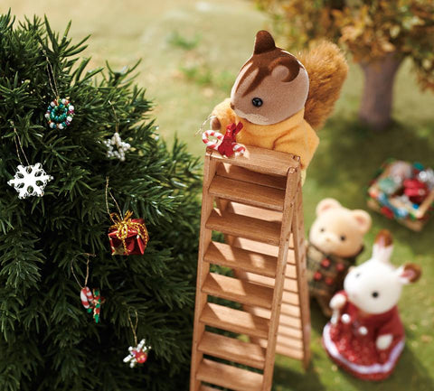 Sylvanian FAmilies squirrel decorating Christmas tree on ladder