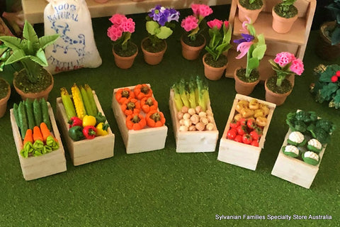 Dollshouse miniature crates of colourful vegetables at market