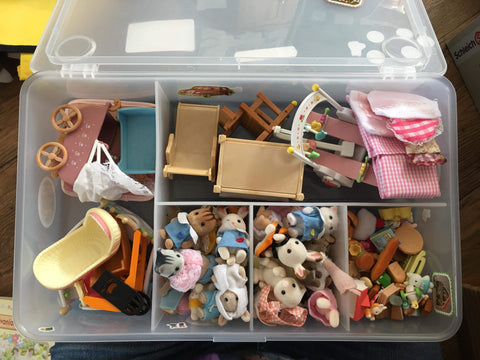 Sylvanian Families using a plastic tub for storage