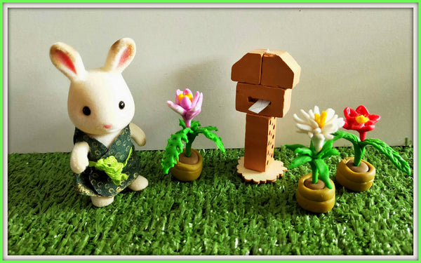 Sylvanian Families mailbox and flowers