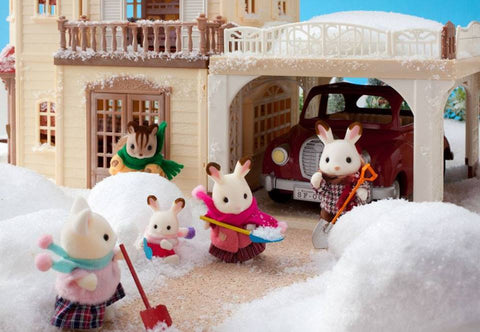 Sylvanian Families shovelling snow in winter carport garage sidewalk