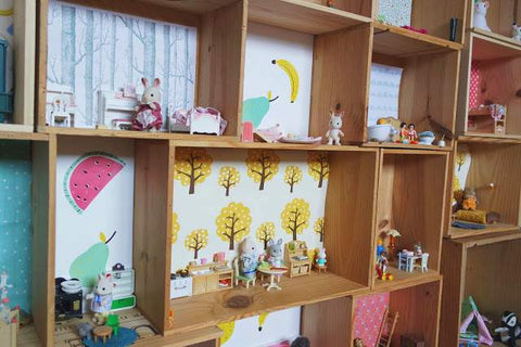 Sylvanian Families storage in wooden crates on wall