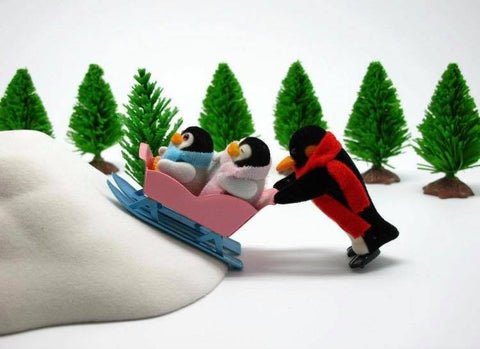Sylvanian Families funny penguins in snow pushing uphill