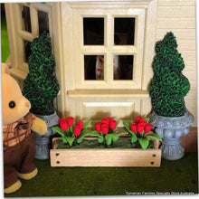 Sylvanian Families with miniature red tulips in window box