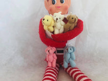 Christmas shelf elf with armful of teddy bears