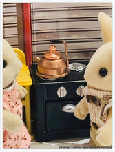 Sylvanian families in kitchen kettle