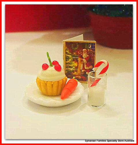 Santa's Treat - cake, candy, carrot and milk on plate
