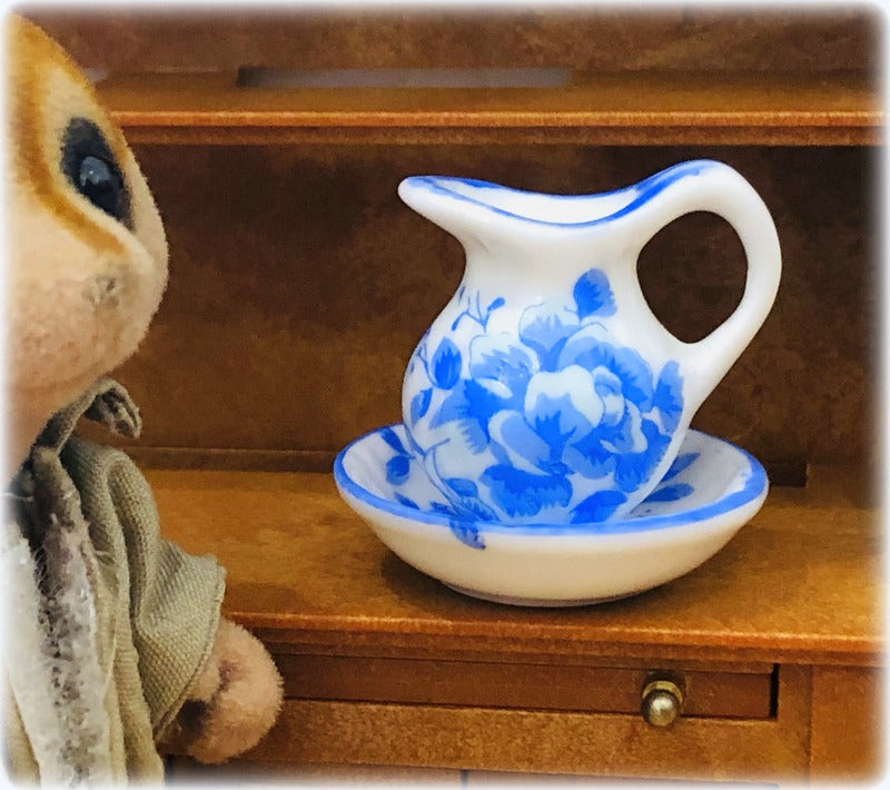 Sylvanian Families meerkat beside blue white jug bowl