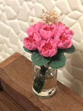 Miniature pink flowers in vase
