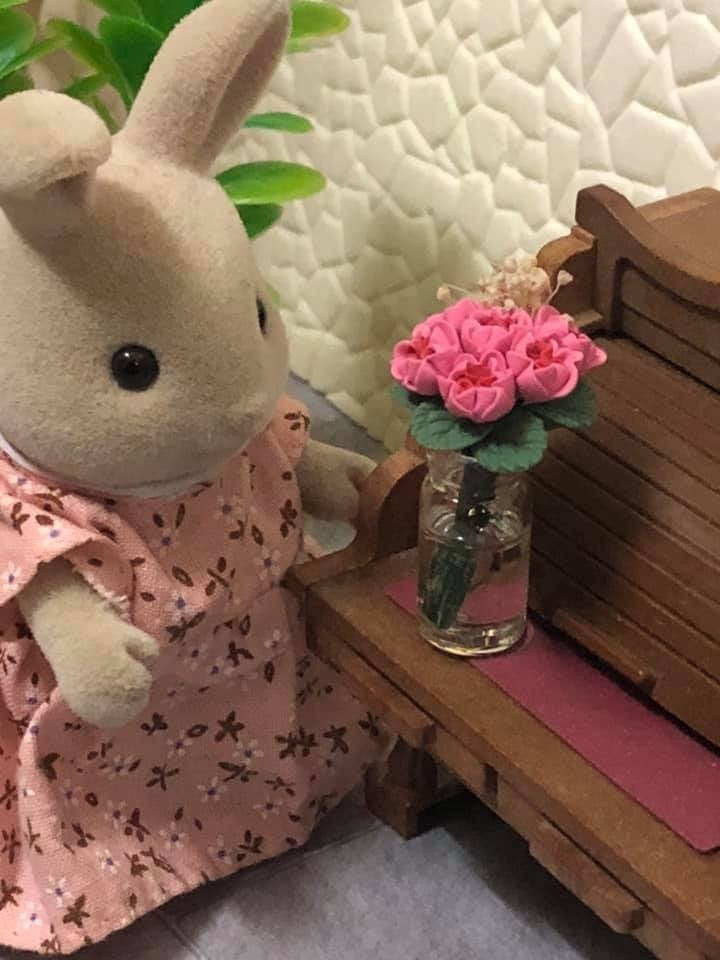 Miniature pink flowers in vase with Sylvanian Families scene