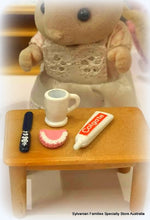 Sylvanian Families trying false teeth