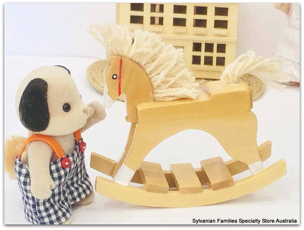 Sylvanian FAmilies and rocking horse wooden