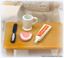 Dollshouse miniature set of false teeth brush toothpaste