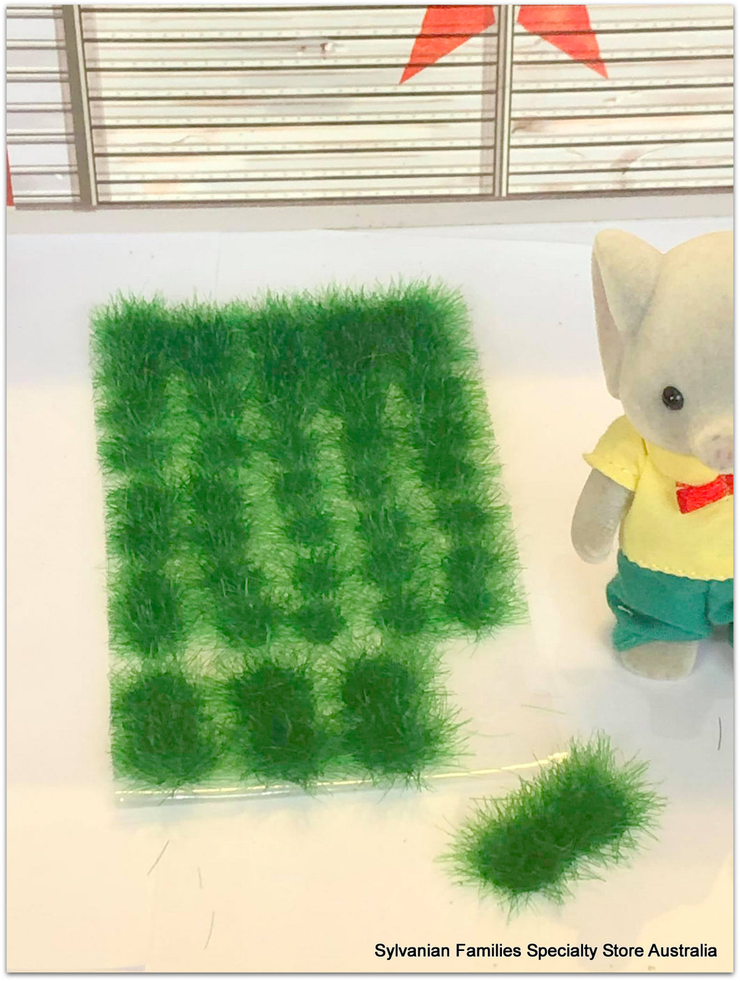 Doll house scene grass clump adhesive