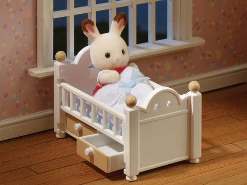Sylvanian Families Chocolate Rabbit Baby in crib cot
