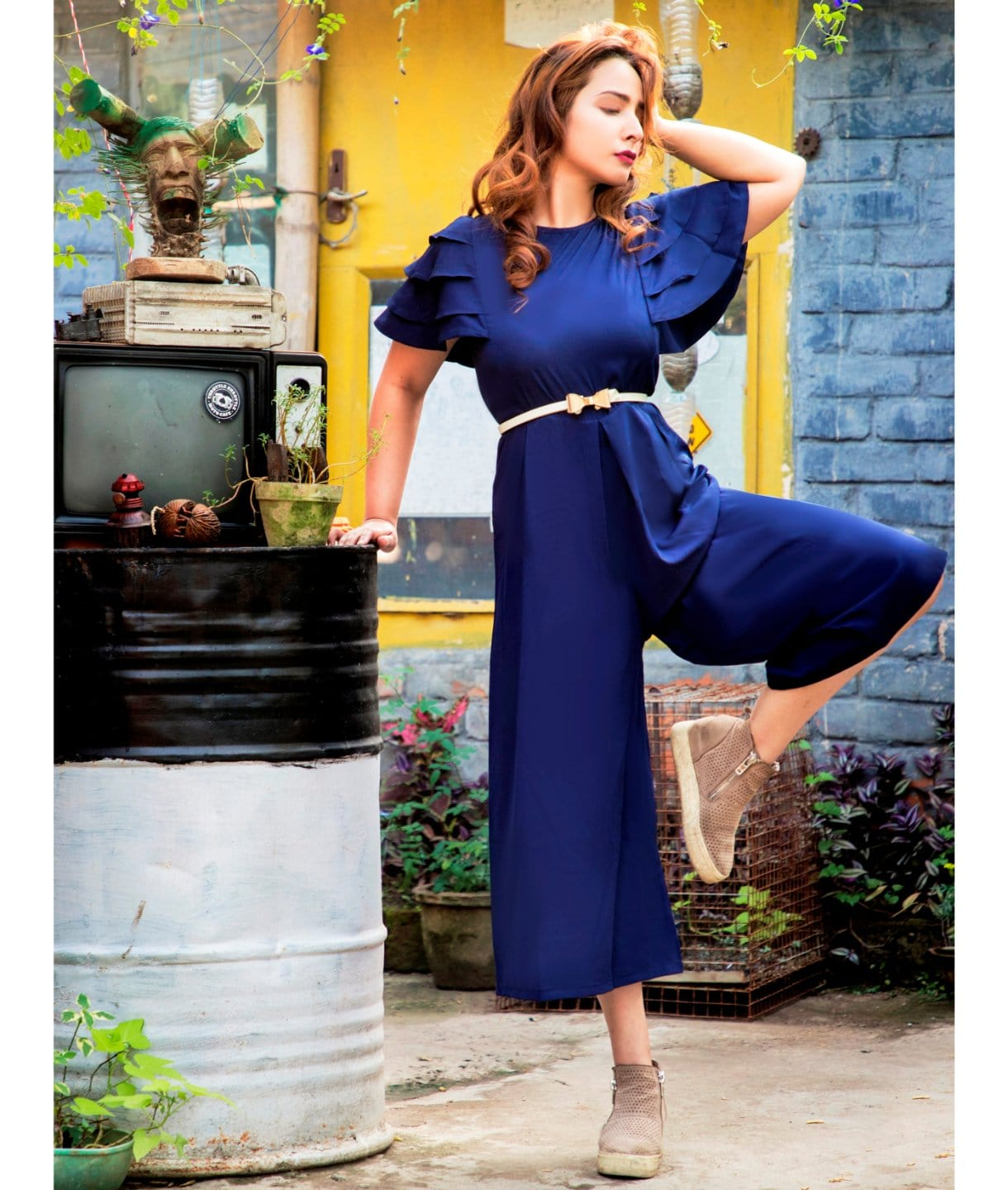 Uptownie Navy Blue solid relax fit culotte jumpsuit with ruffled sleeves