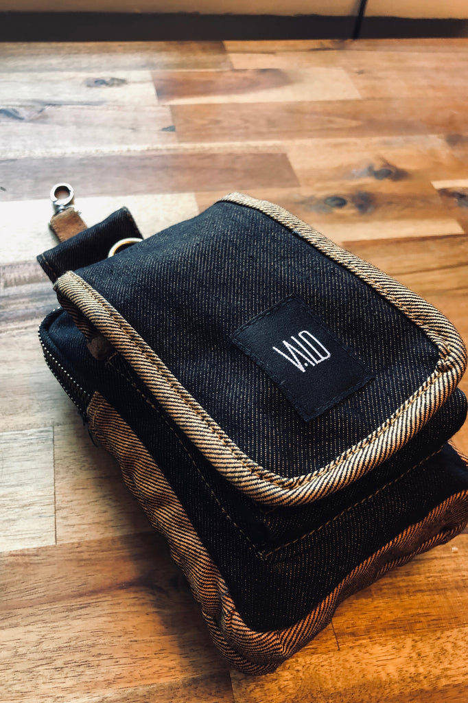 TASKU - A functional belt bag made from recycled orange / black denim