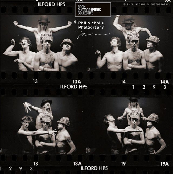 INSIDE INFO: 010: Our photographers give you the inside information behind the shoot. RED HOT CHILI PEPPERS CONTACT SHEET, BY PHIL NICHOLLS.