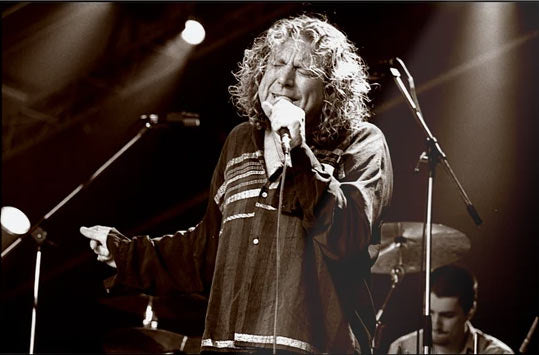 Robert Plant performing on stage