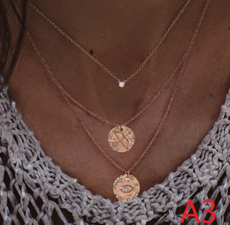 Three layer necklace set with charms