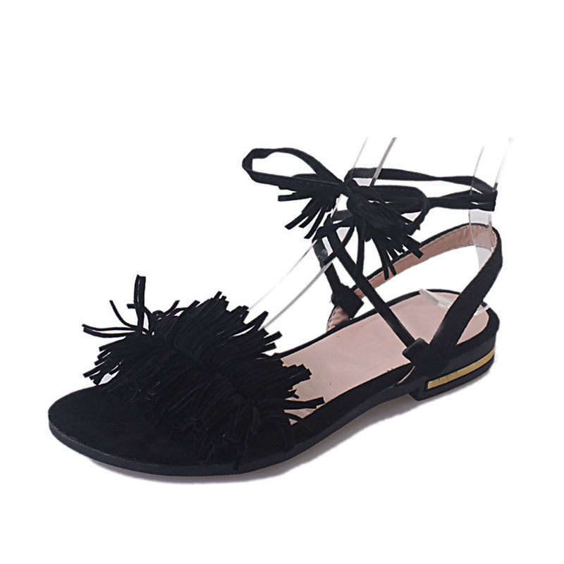 Fringe sandal in faux leather with fringes