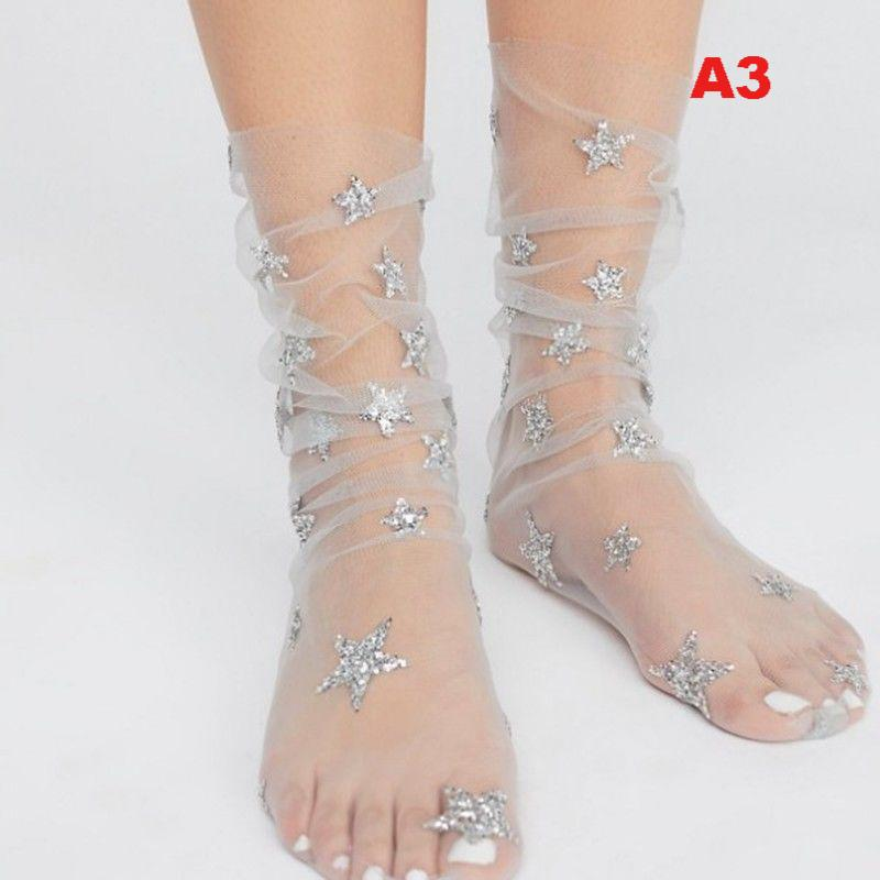 Transparent Stella socks with star embroidery