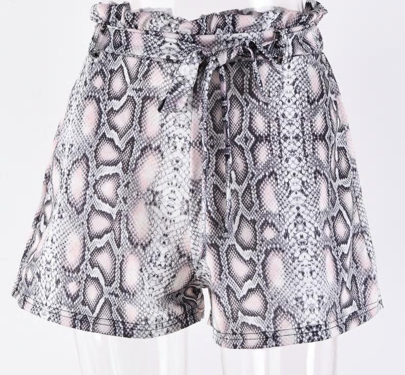 Trix high-waisted shorts with belt and Python pockets