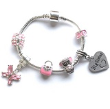 childrens pink fairy big sister bracelet with charms and beads