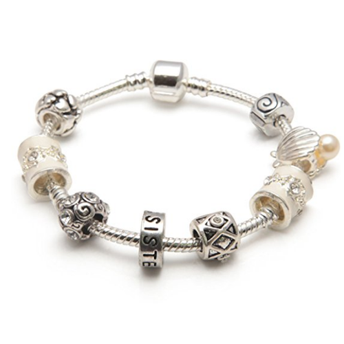cream sister bracelet with charms and beads
