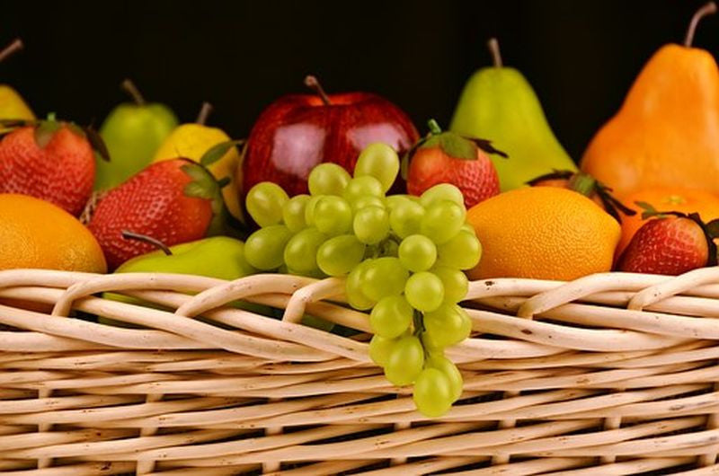 Basket filled with different color fruits