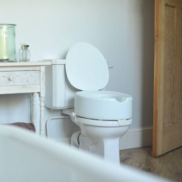 Buy Raised Toilet Seat With Lid At Spring Chicken