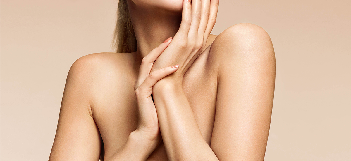 A woman's torso with soft glowing skin