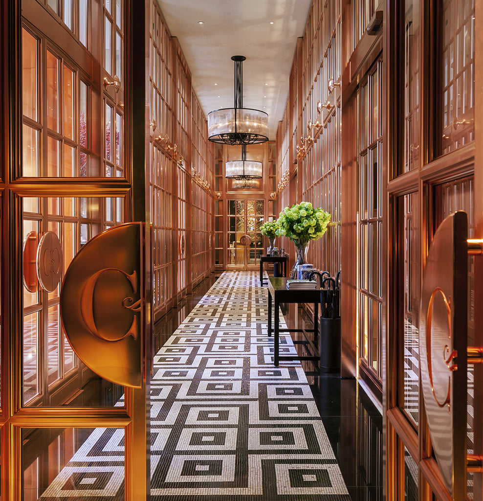 5 star luxury hotel Rose gold glass panelled corridor
