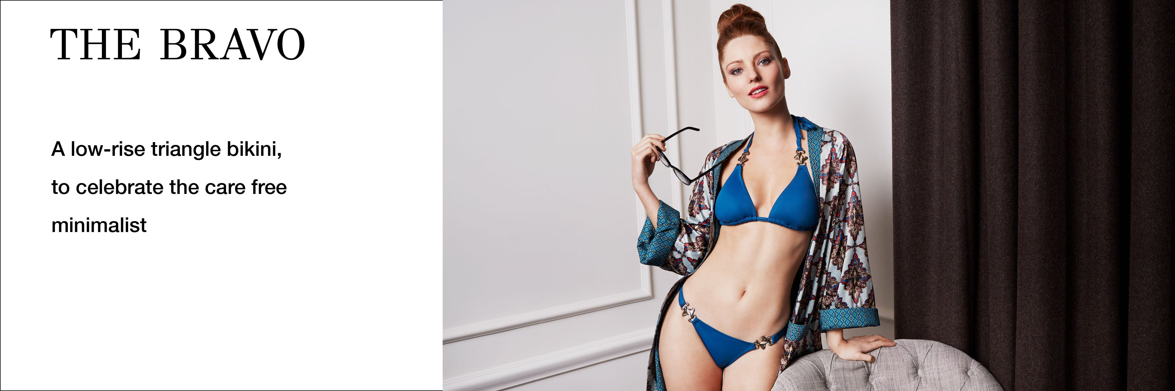 Woman in Designer Swimwear Bravo blue string triangle low rise bikini holding a pair of glasses