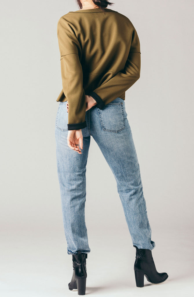 Native Youth structured olive green, boxy sweater with black turn up sleeves.