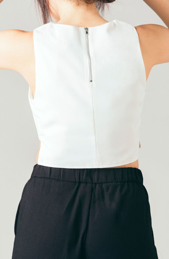 The Coverii white cropped sleeveless shell tank top with cut out side panel bandeau.