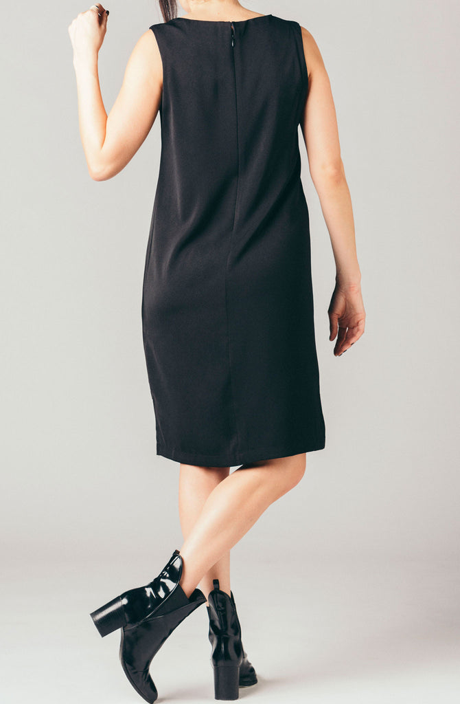 The Coverii black sleeveless, high low shift dress with lace panel across deep v neck line.