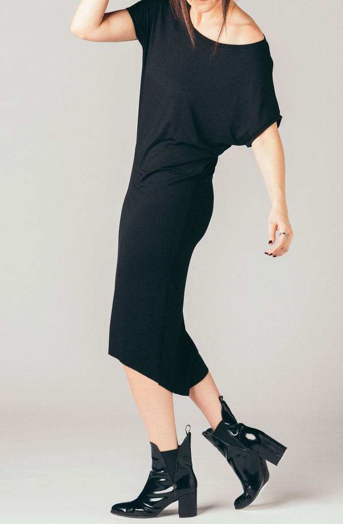 Corinne Collection black short sleeve loose stretchy t-shirt dress, below the knee, knee length soft jersey fabric with cap sleeve.
