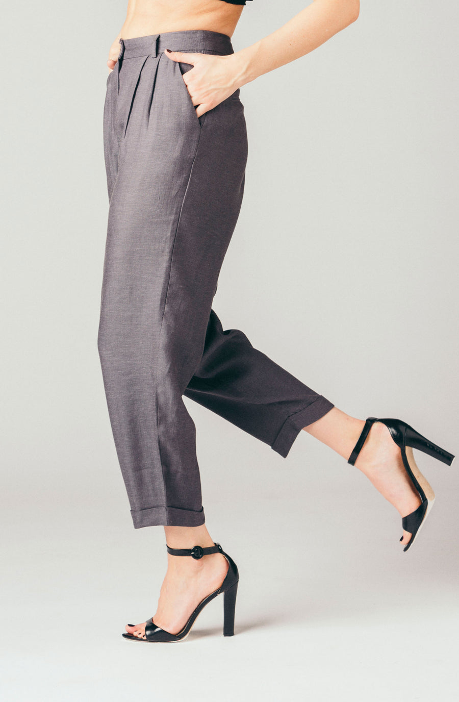 Native Youth grey, tapered, cropped trouser pants in a linen blend .