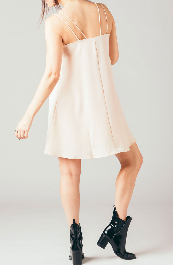 The Coverii peach, pink strappy short a-line cami dress.