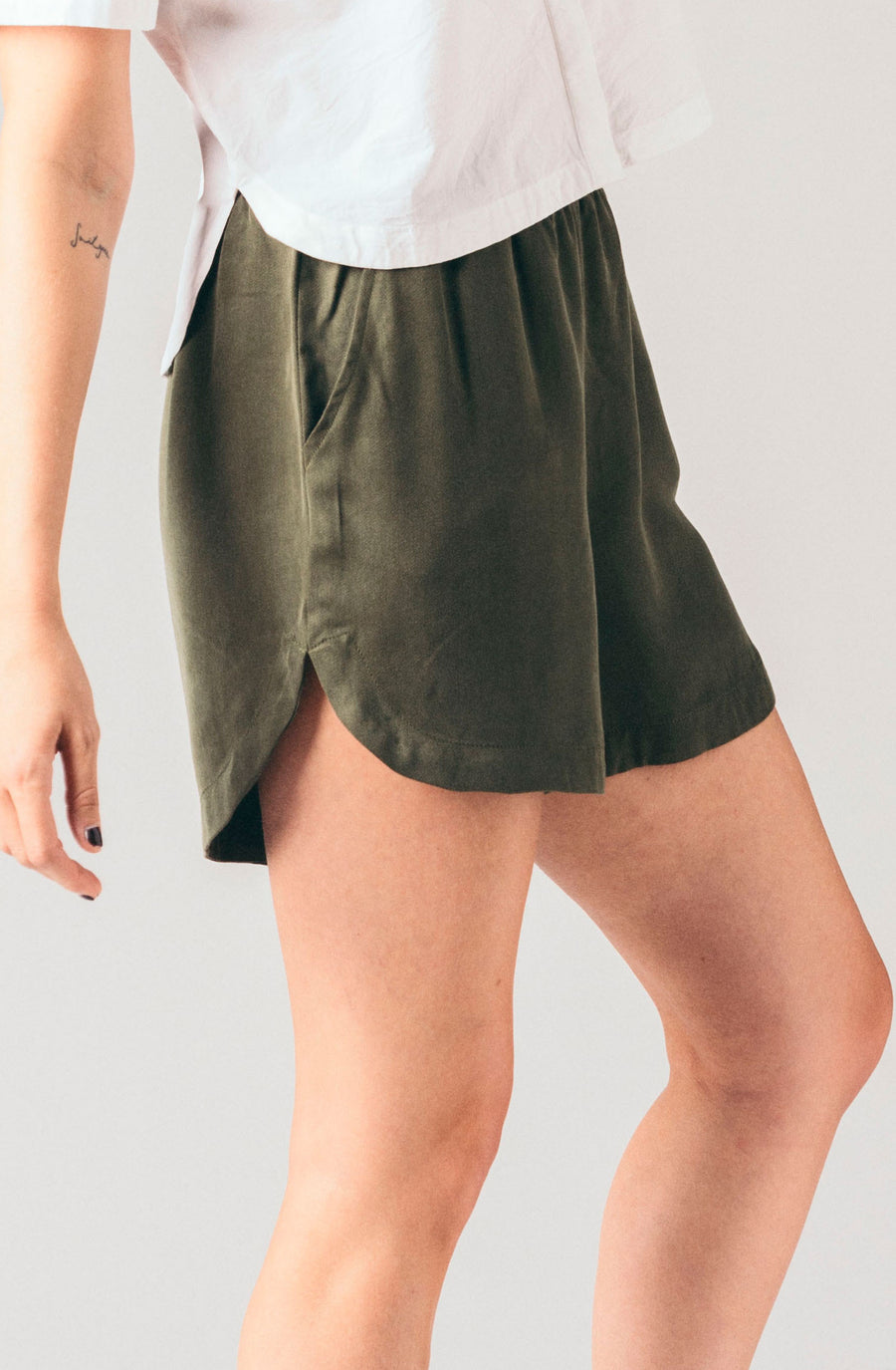 Native Youth olive green, fatigue green sporty casual elastic band shorts.