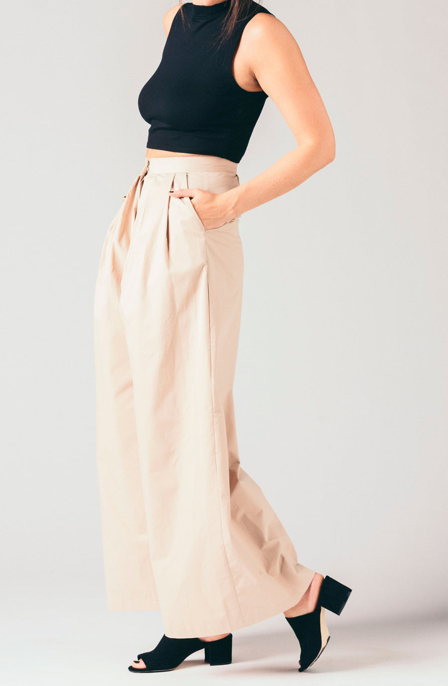Style Mafia tan high waisted, pleated wide leg trouser pants.