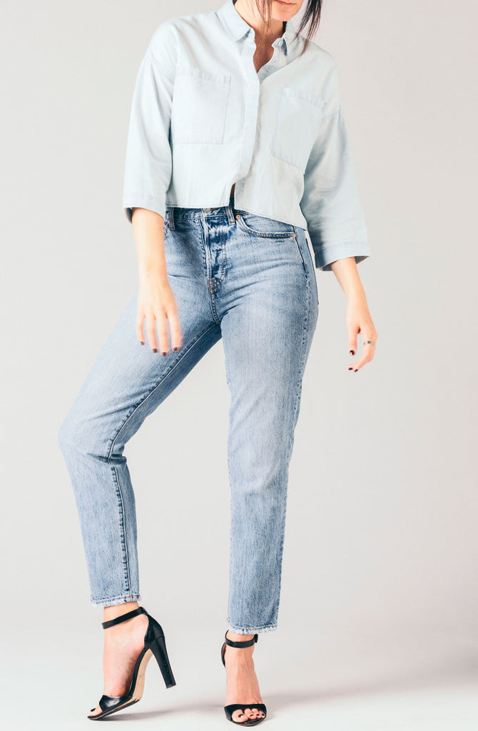 Native Youth short sleeve, soft, light washed denim chambray cropped blouse with front patch pockets.