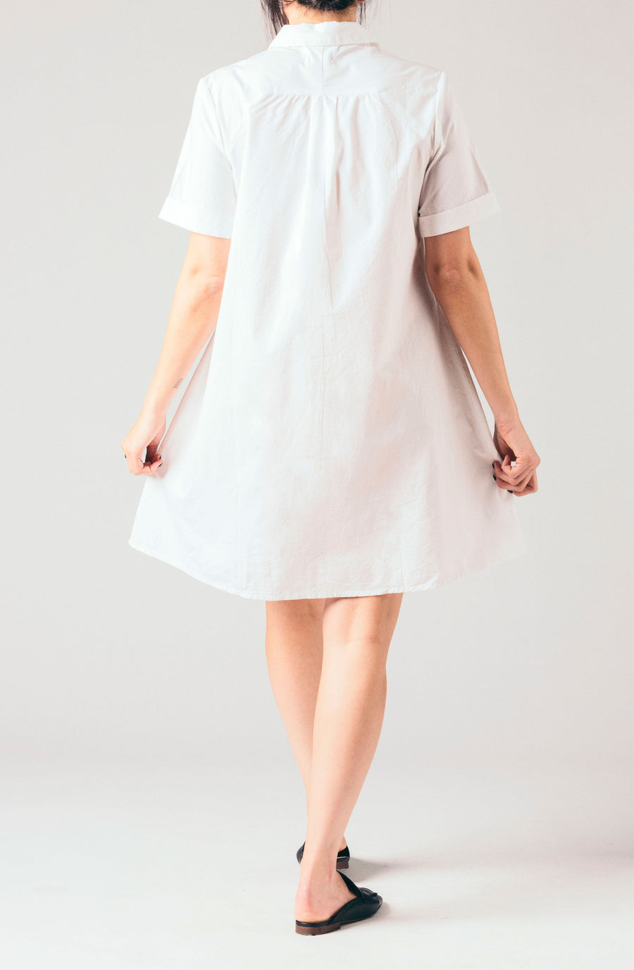Native Youth white short shirt dress with small slits collared white short sleeve blouse.