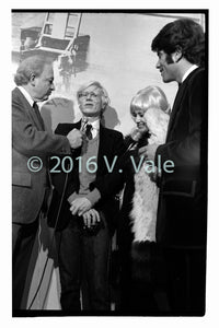 Photo print: Andy Warhol with interviewer