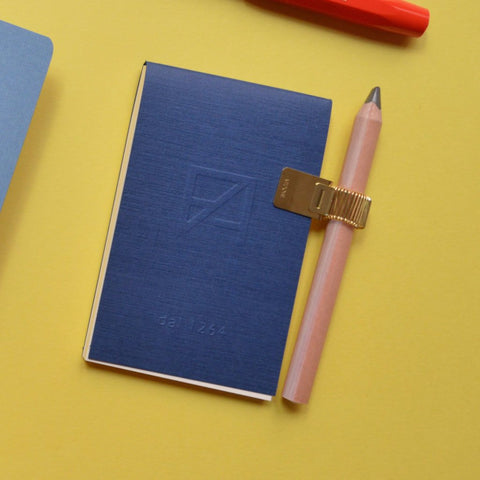 Notebook clip pen holder in gold