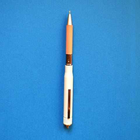 Brass pen in white