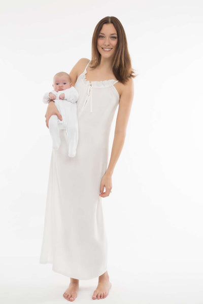 New mum in Cucumber Clothing thermoregulating, easy care, stylish loungewear style dress holding a new baby