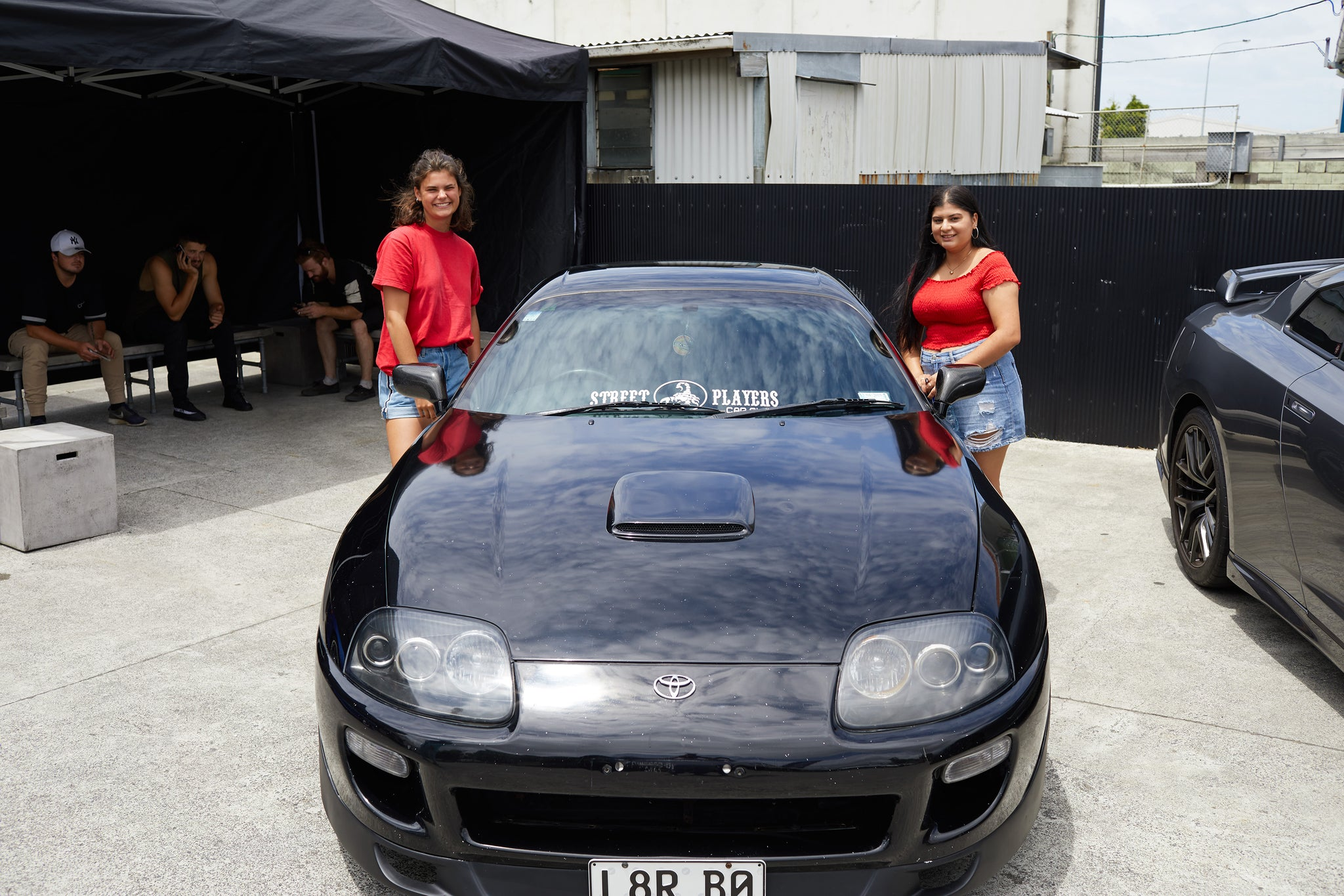 Toyota Supra and babes at Scarles